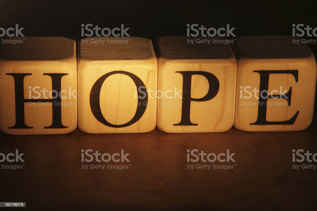 Building Blocks Religious message of Hope in gold spelt out with blocks Alphabet Stock Photo