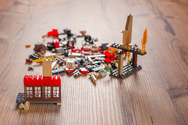 building blocks,lego on the wood table - lego house stock photos and pictures