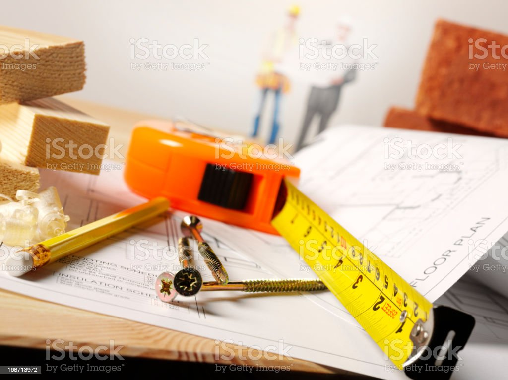 Building Blueprints and Tape Measure royalty-free stock photo