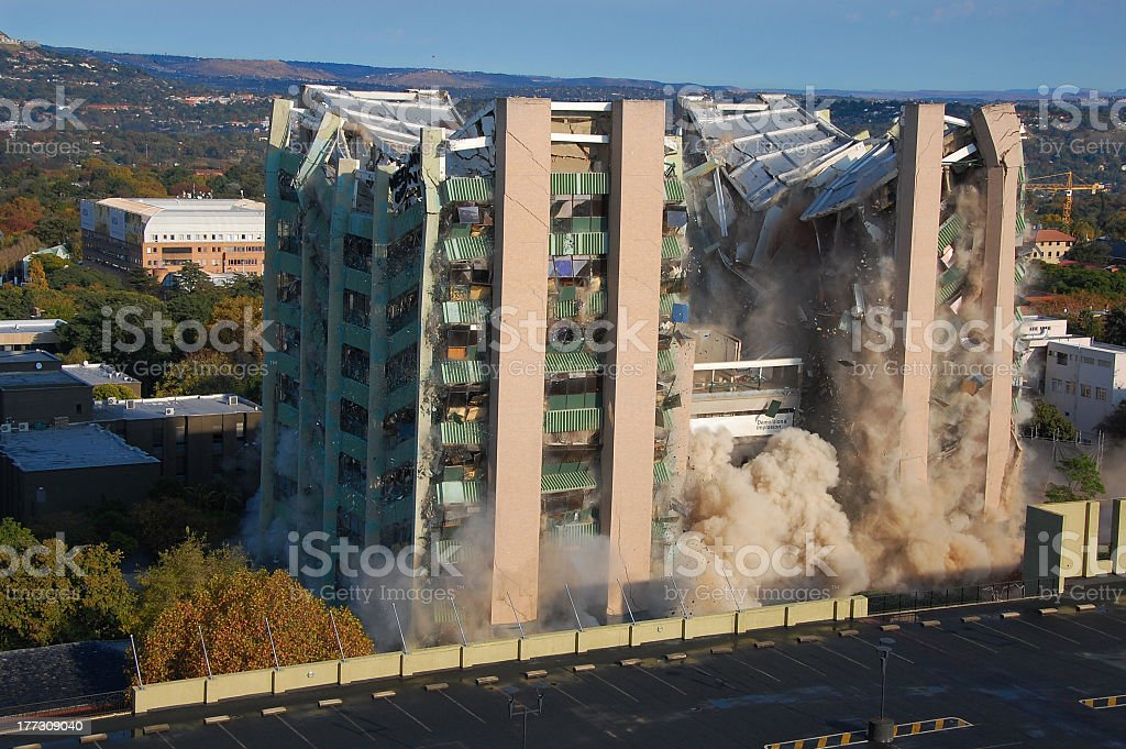 Building collapses from a planned demolition  stock photo