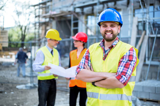 building construction crew - construction worker stock photos and pictures