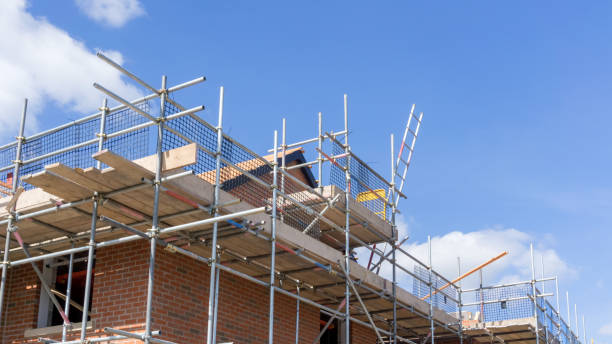 Building Construction A new house development under construction scaffolding stock pictures, royalty-free photos & images