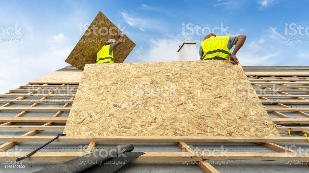 Building Construction Process Of New Wooden Roof On Wood Frame