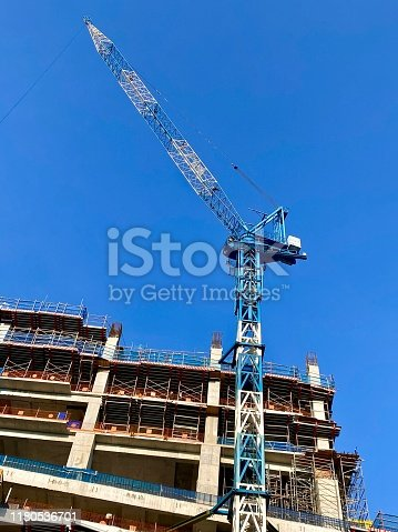 Building construction site and crane.
