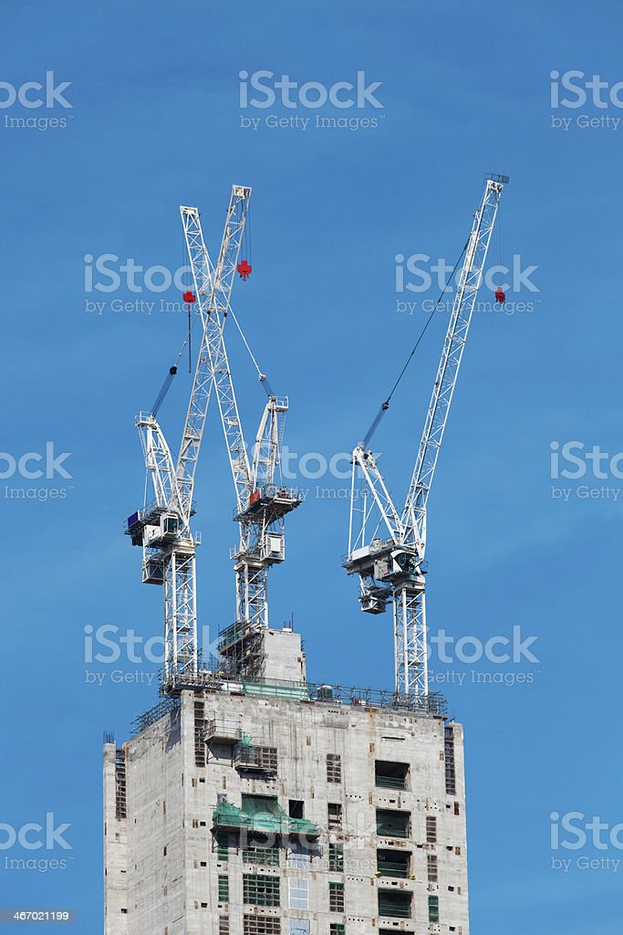 Building construction - three cranes royalty-free stock photo