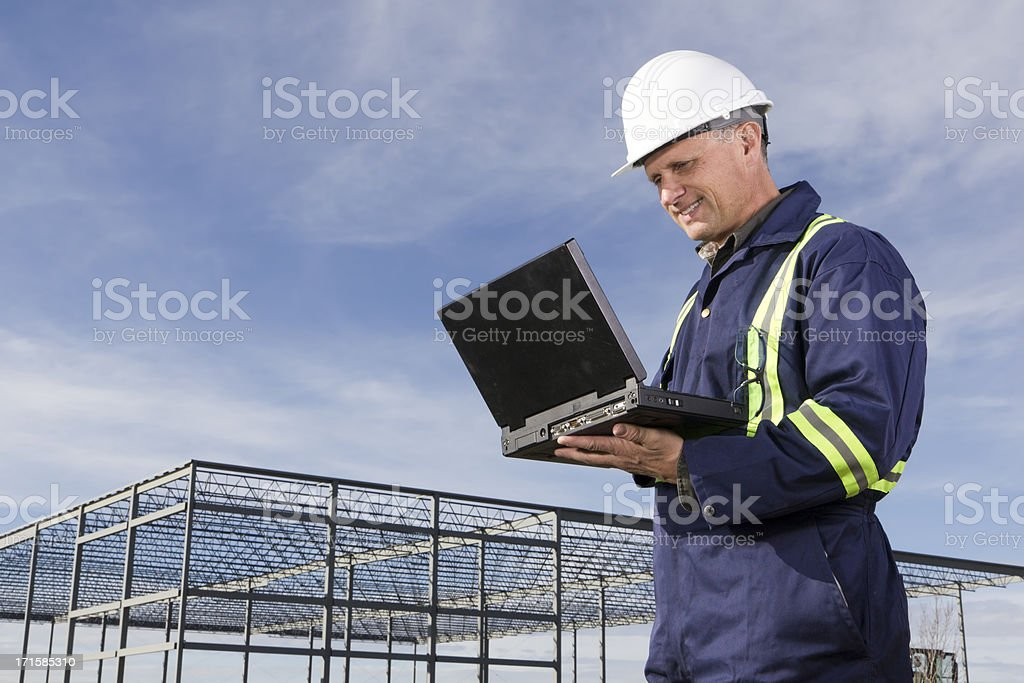 Building Contractor and Computer royalty-free stock photo