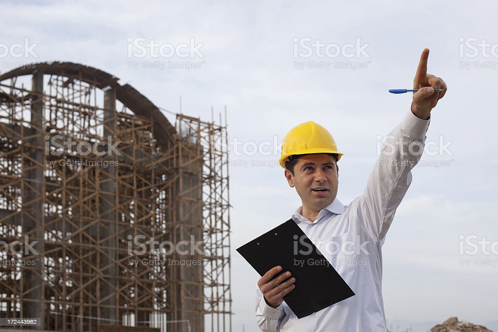 Building contractor giving orders in construction site royalty-free stock photo
