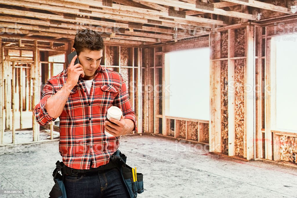Building contractor on phone in construction site