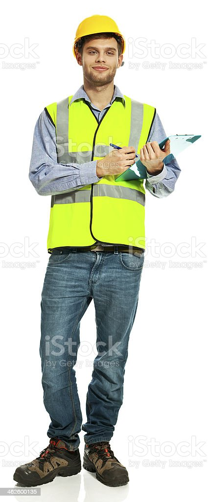 Building Contractor Portrait of smiling young building contractor wearing hardhat and reflective vest, holding clipboard and smiling at camera. Studio shot, white background. 20-29 Years Stock Photo