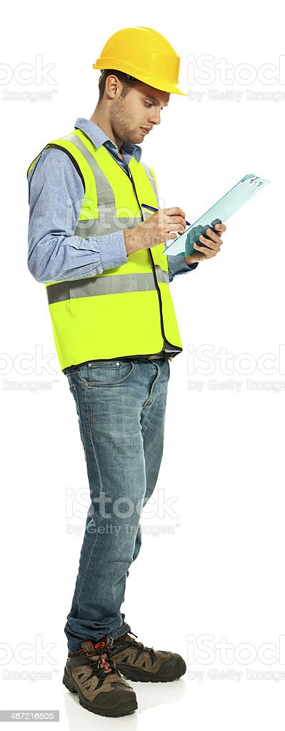 Building contractor Young building contractor wearing hardhat and reflective vest taking notes on a clipboard.  Studio shot, white background. 20-29 Years Stock Photo