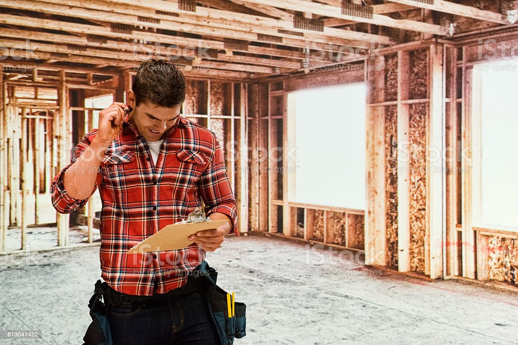 Building contractor working in construction site