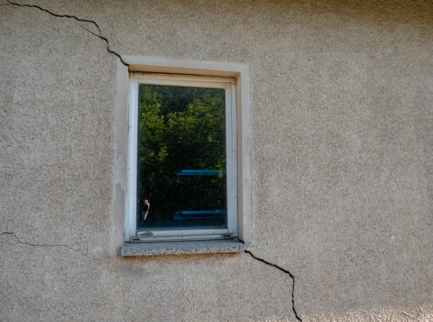 building damage in a wall at the window cracks - defects stock pictures, royalty-free photos & images