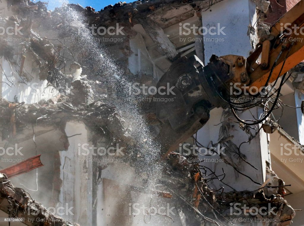 Building demolition and watering due to dust stock photo