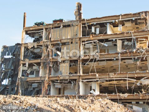 This building is either being demolished or else has been through a catastrophe such as a tornado or hurricane.