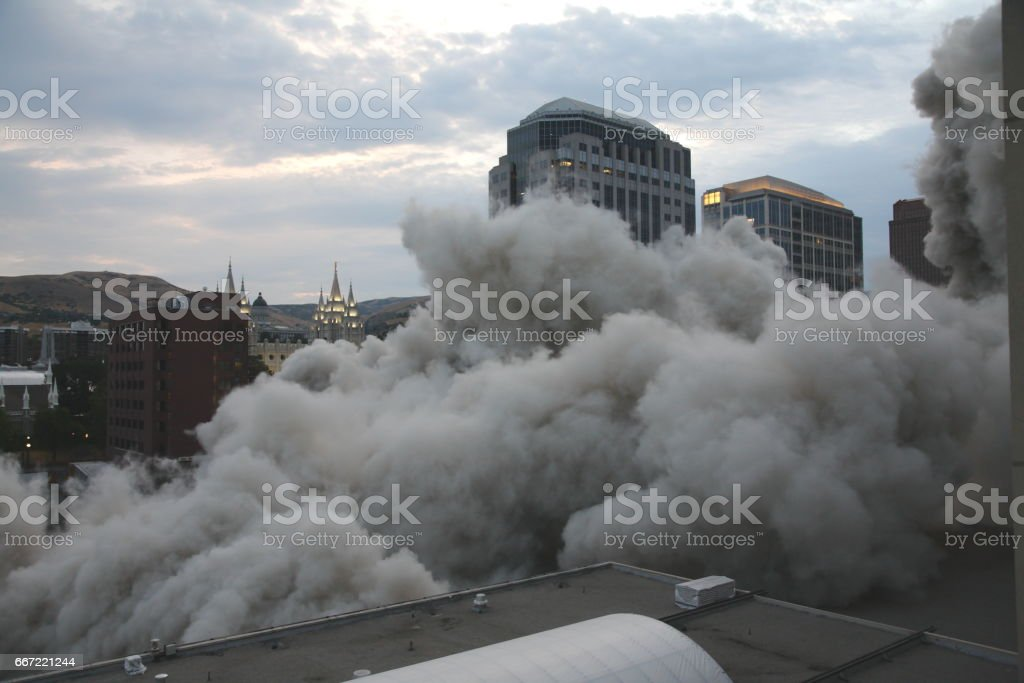 building demolition with explosives stock photo