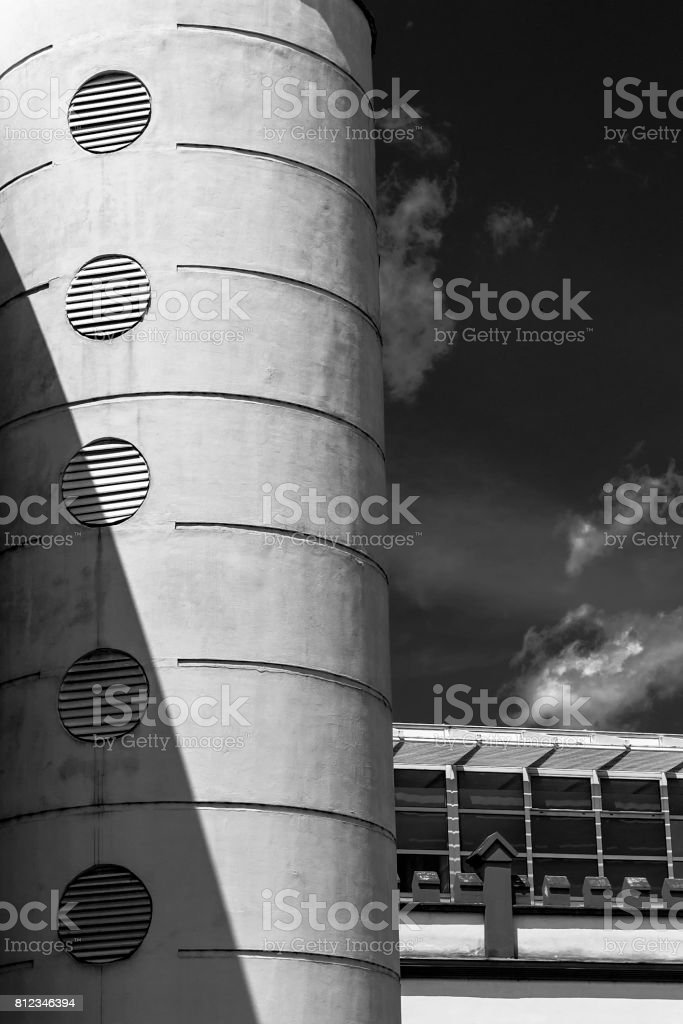 Building detail with cylindrical tower and vents. stock photo