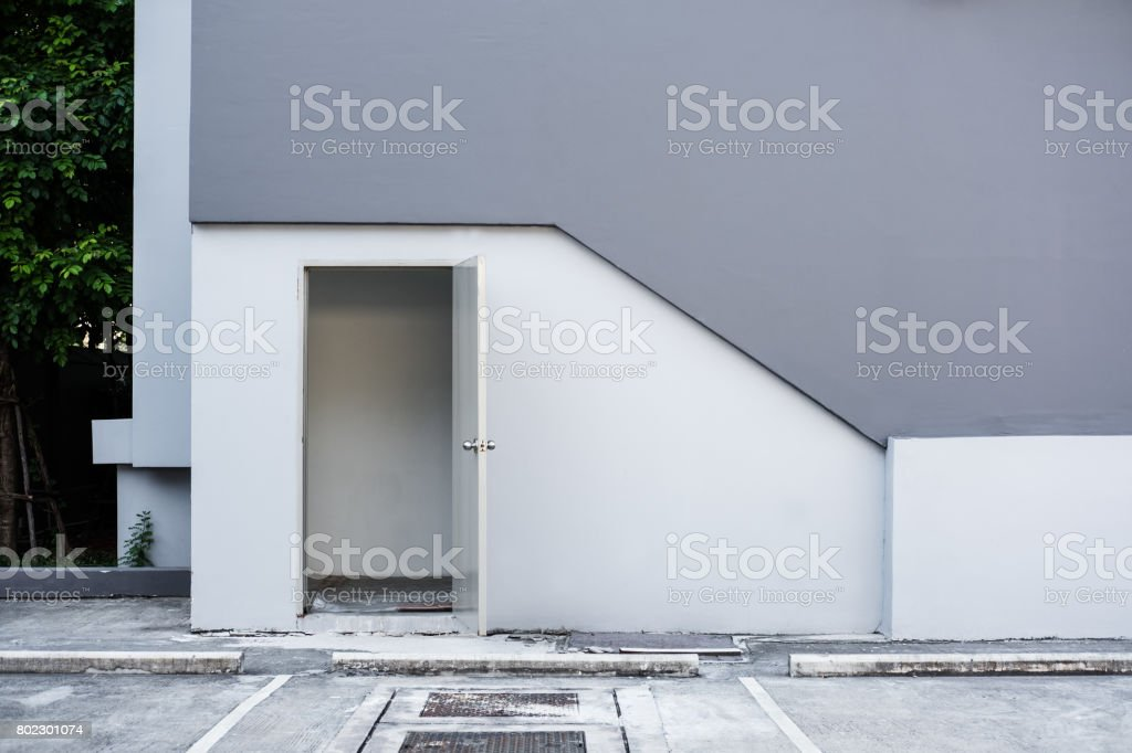 Building emergency exit back door, with empty parking lots stock photo