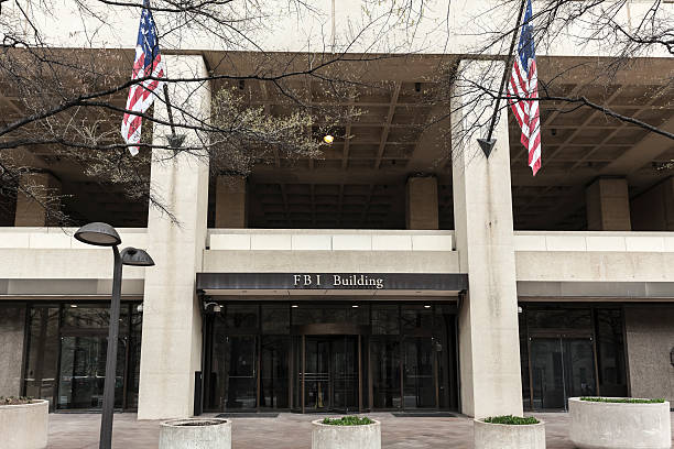 FBI Building Entrance Flanked by Flags stock photo