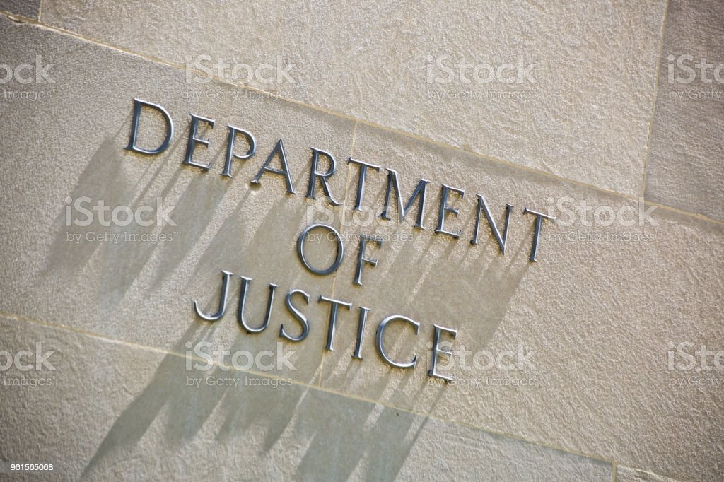 Building Entrance Sign for the Department of Justice in Washington DC stock photo
