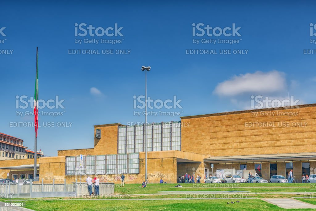 Florence, Italy- May  15, 2017 : Building facade of Florence  railways station- Firenze Santa Maria Novella with people. stock photo
