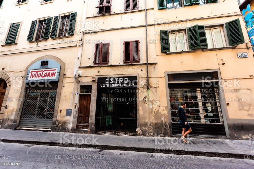 Building facade of shop store in Firenze, Italian city with sign and...