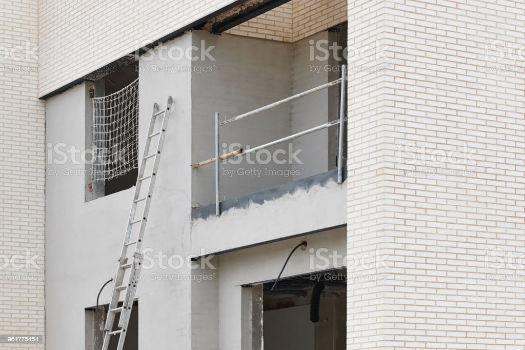 Building facade under construction. Brick wall structure royalty-free stock photo