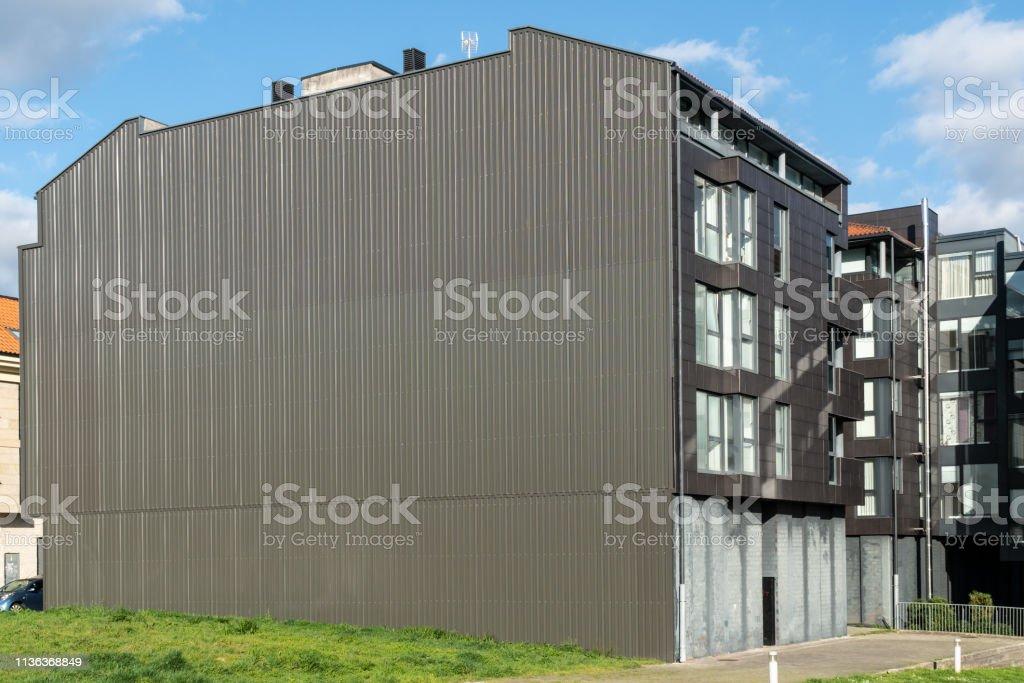 Building facade with metallic cladding stock photo