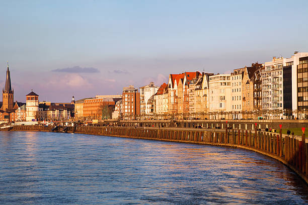 building facades of Dusseldorf embankment at the sunset, Germany stock photo