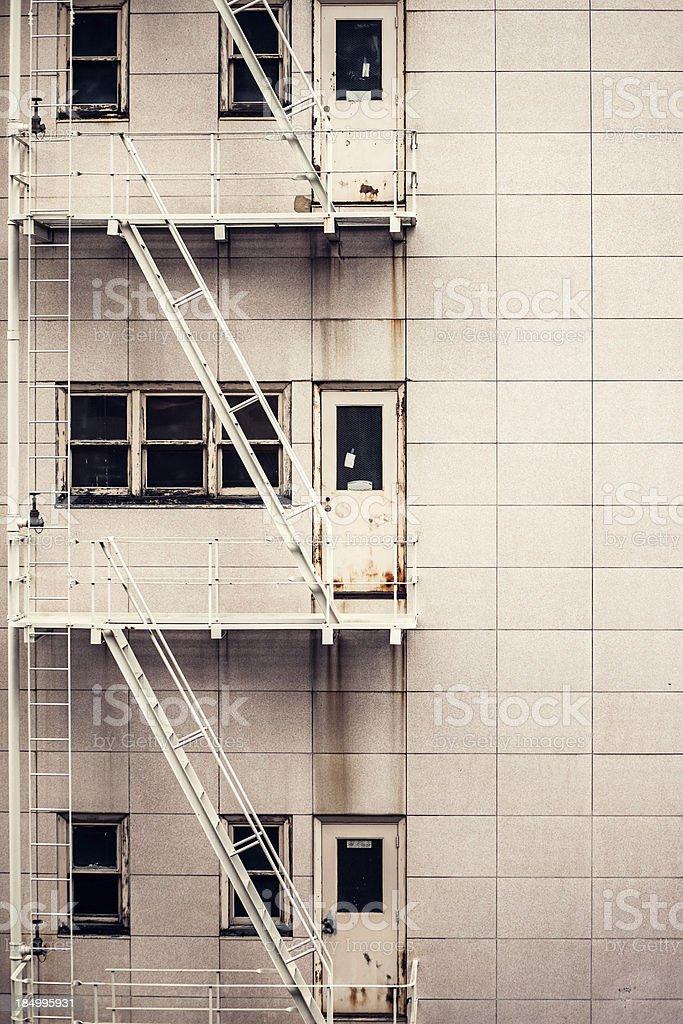 Building Fire Escape in Grunge Pattern stock photo