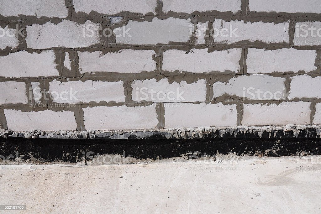 Building foundation waterproofing. Building new house. stock photo