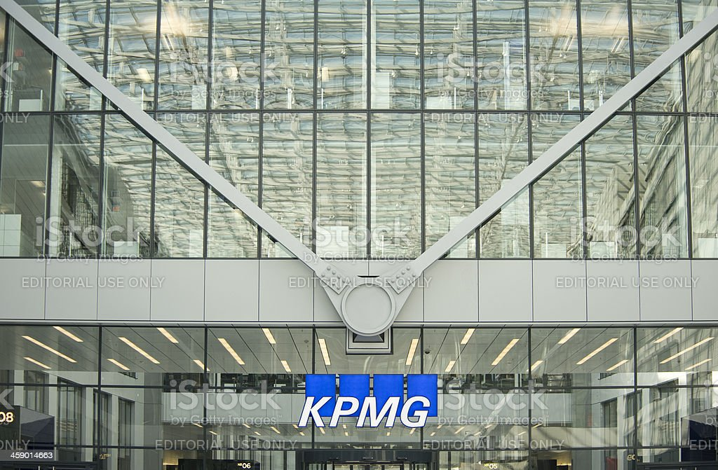 "KPMG building, Frankfurt, Germany ""Frankfurt am Main, Germany- March 8, 2012: KPMG Logo at the facade of their office building at the Frankfurt Airport. The company is  heatquartered in Amsteram, The Netherlands. They are one of the largest professional services and accountancy firms in the world."" Alphabet Stock Photo"