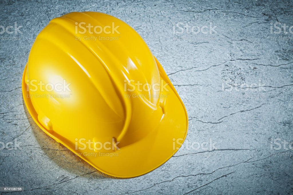 Building helmet on metallic surface construction concept royalty-free stock photo
