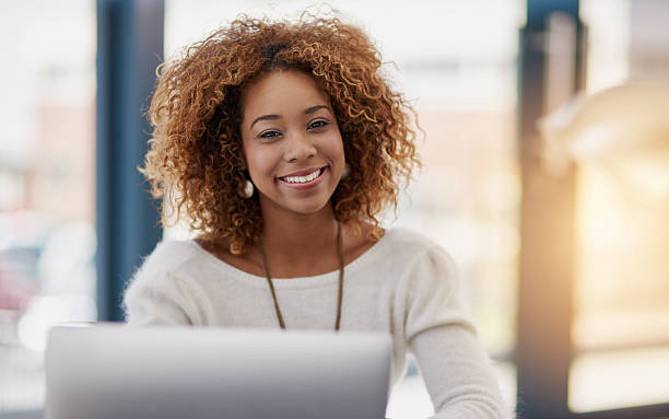 Building her business on success at a time stock photo