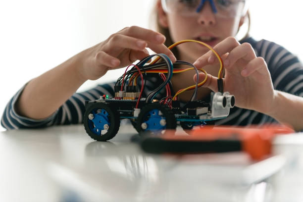 Building her own robotic car stock photo