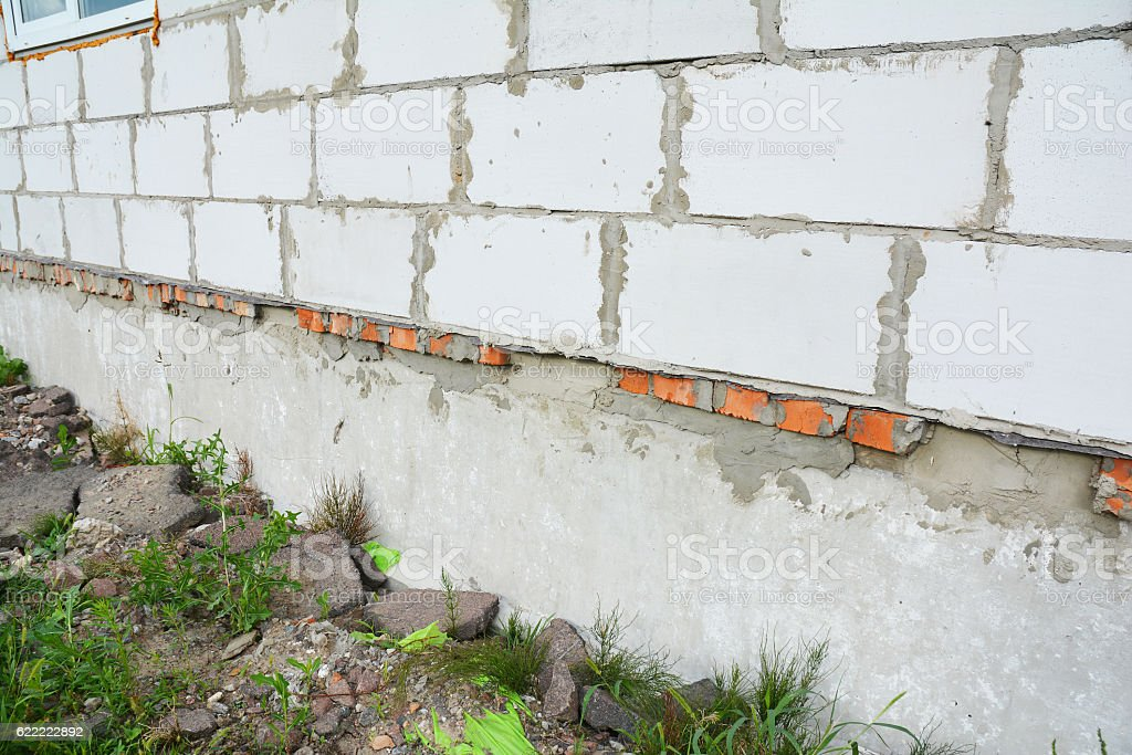 Building house construction foundation wall waterproofing. stock photo