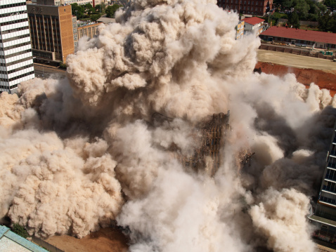 Fourth in series of demolition by implosion of four buildings in one block in Johannesburg to clear the way for a new parking lot for the new Gautrain underground railway line.