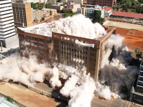 Third in the series of demolition by implosion of four buildings in one block in Johannesburg to clear the way for a new parking lot for the new Gautrain underground railway line.