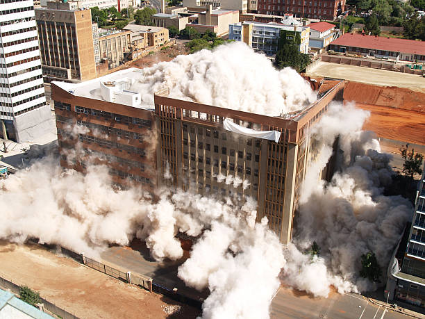 Building implosion in Johannesburg, South Africa Third in the series of demolition by implosion of four buildings in one block in Johannesburg to clear the way for a new parking lot for the new Gautrain underground railway line. collapsing stock pictures, royalty-free photos & images