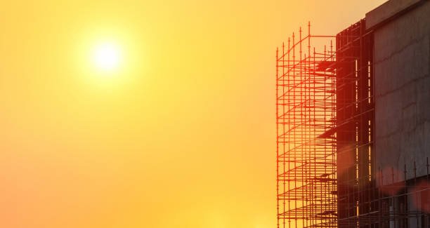 building in construction at sunset with scaffolding