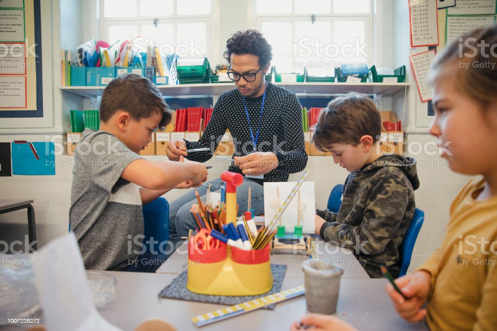 Building in Elementary Class with their Teacher stock photo