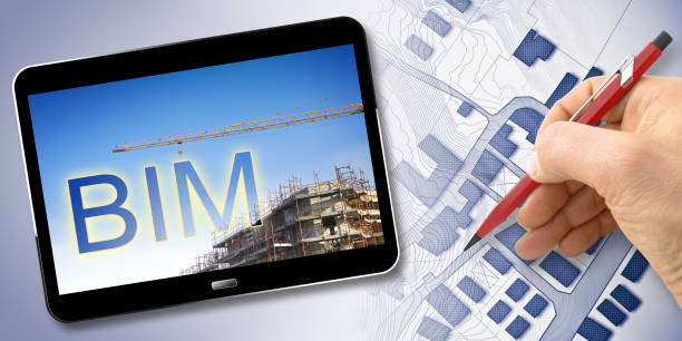 Building Information Modeling (BIM), a new way of architecture designing - concept image with a metal tower crane in a construction site and 3D render of a digital tablet stock photo