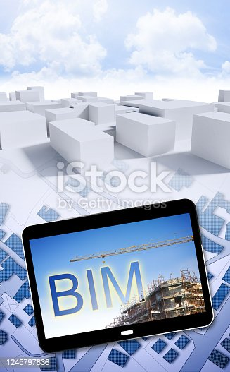 istock Building Information Modeling (BIM), a new way of architecture designing - concept image with a metal tower crane in a construction site with hanging text BIM over a city map - 3D Rendering 1245797836