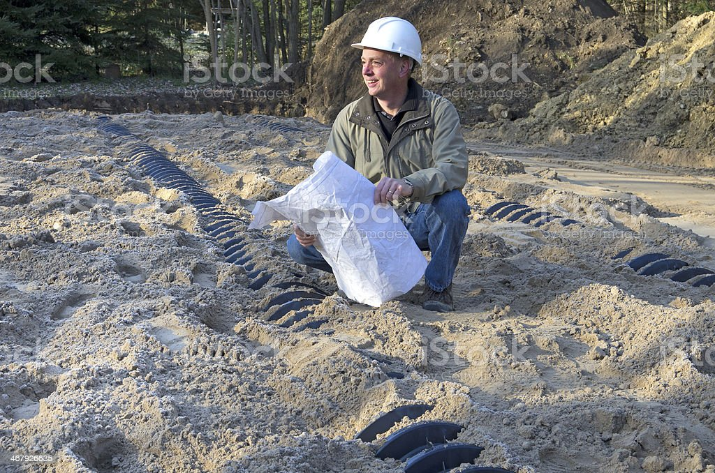 Building Inspector and Septic System stock photo