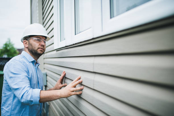 Building inspector checking the windows of a residential building stock photo