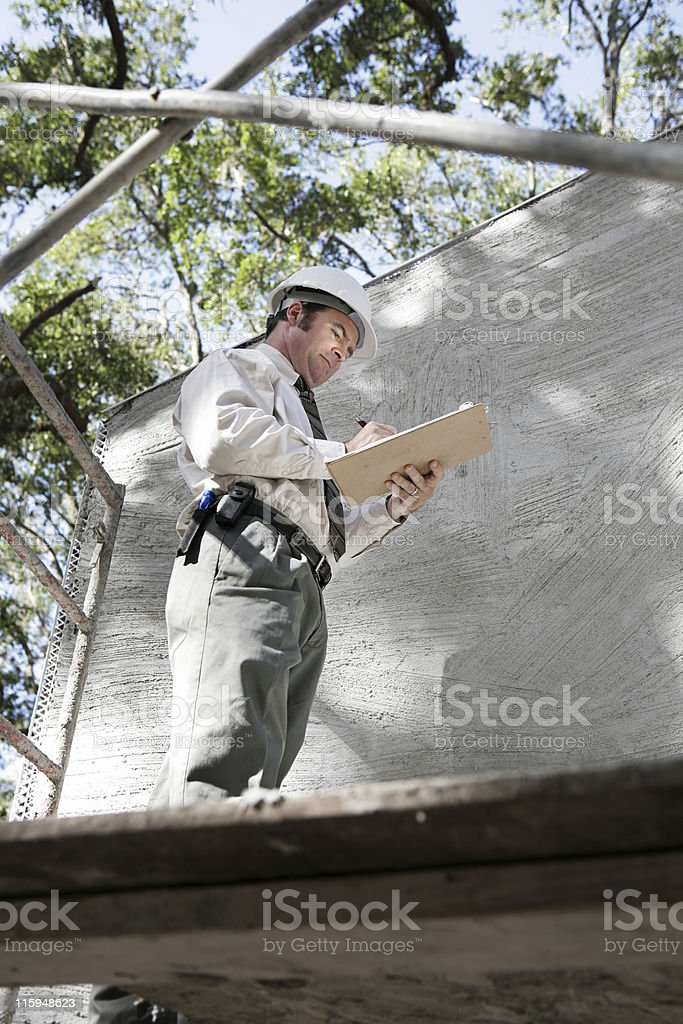 Building Inspector on Scaffolding royalty-free stock photo