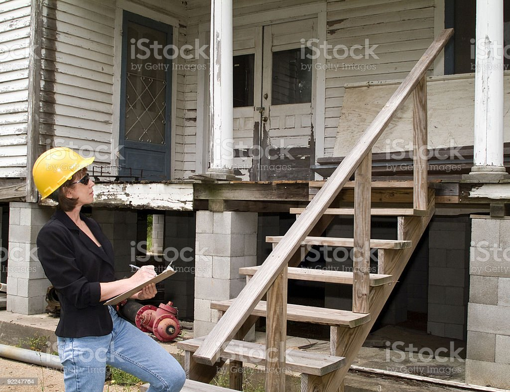 Building inspector performing an inspection royalty-free stock photo