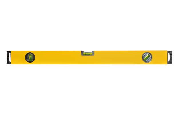 Construction métal niveau jaune avec indicateur de trois bulles isolé sur fond blanc. Vue de face - Photo