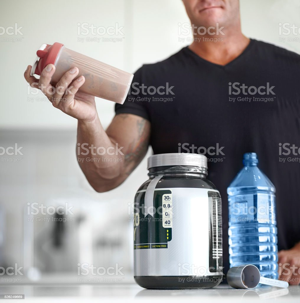 Building muscle with protein shakes stock photo