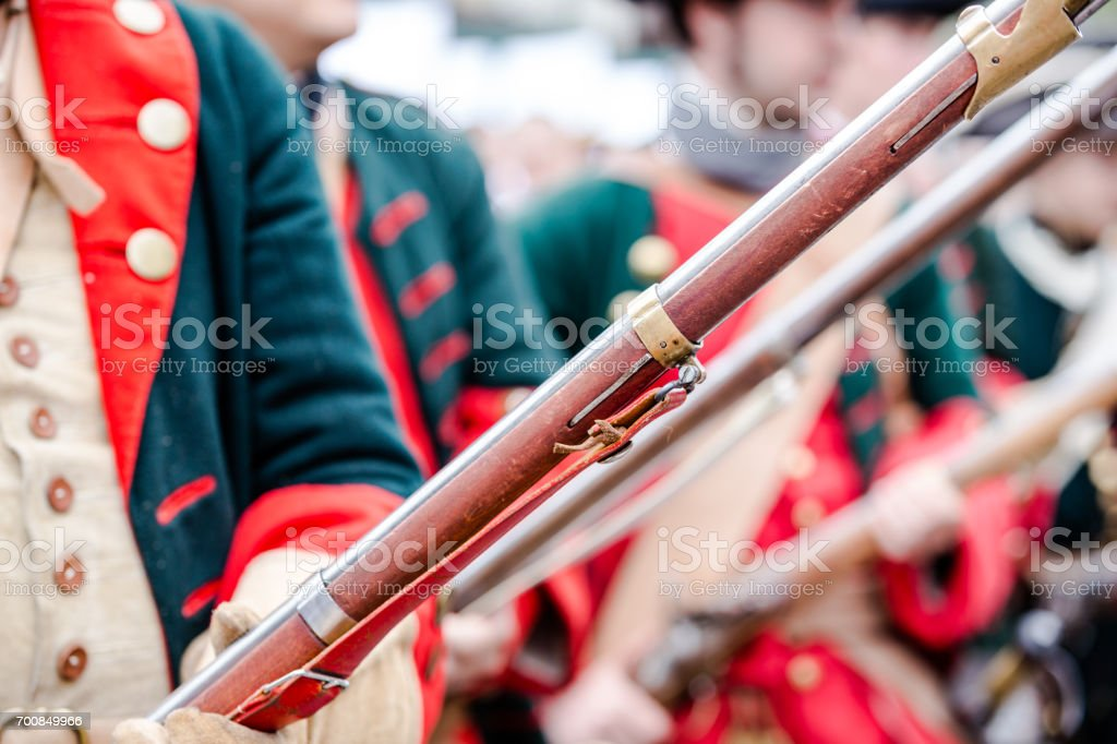 Building musketeers with guns. Focus on the gun stock photo