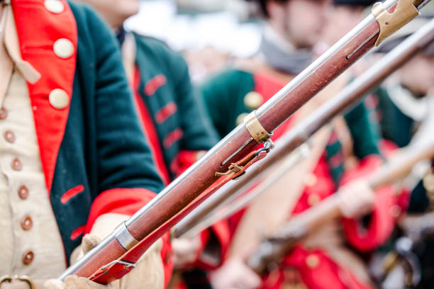Building musketeers with guns. Focus on the gun Building musketeers with guns. Focus on gun puebla state stock pictures, royalty-free photos & images
